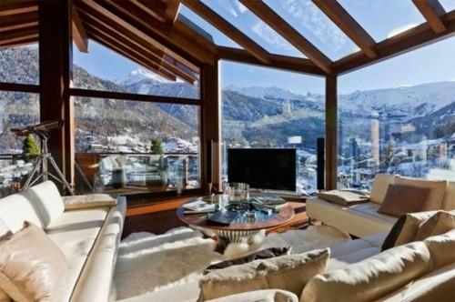 chalet bois ossature pan verre vue panorama paysage montagne interieur