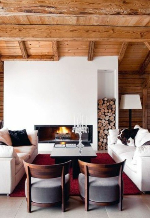 chalet bois toit toiture fauteuils cheminee buche séjour