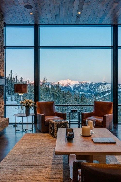 chalet interieur fauteuils table vue baie vitre menuiserie montagne paysage