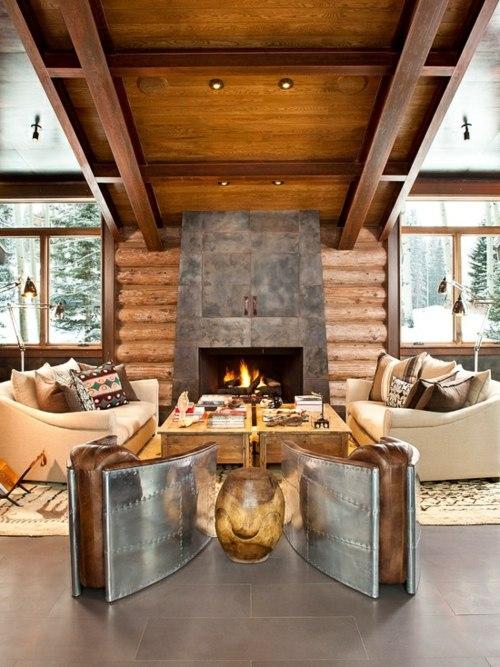chalet interieur moderne fauteuil design metal toit travee cheminee bois canape rondin séjour