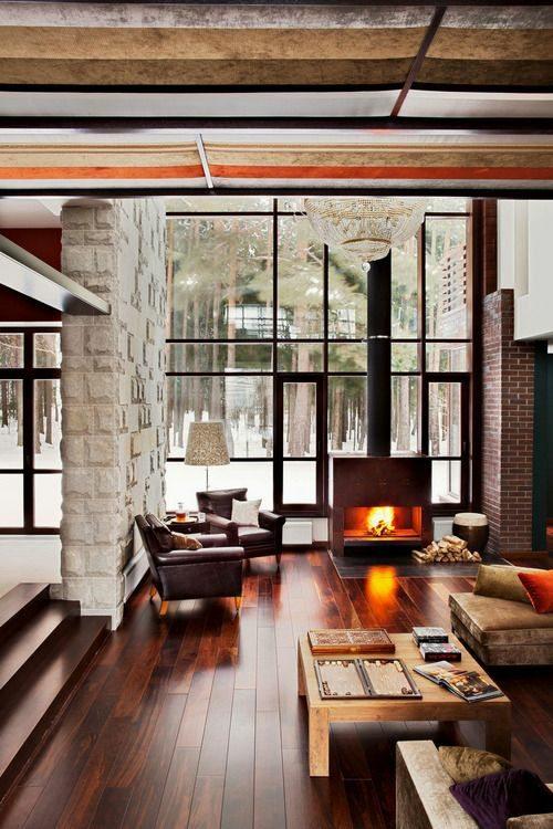 chalet lustre cheminee feu allumee parquet niveau bois foret pin