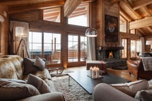 chalet luxe cabine chasse montagne interieur bois chaleureux cheminee fauteuil cuir