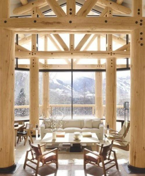 sejour chalet bois construction boulon ferme portique colonne tronc exterieur paysage vue menuiserie