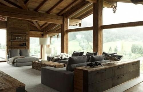 sejour chalet bois construction poteau bois canape divan interieur