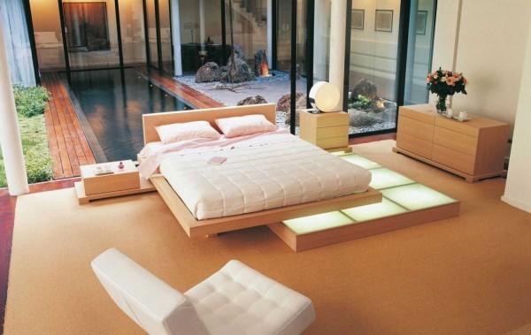 grand lit bois chambre coucher vue piscine