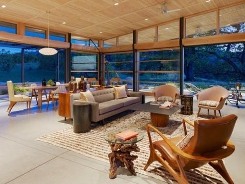 interieur sejour scandinave veranda vitre fauteuil