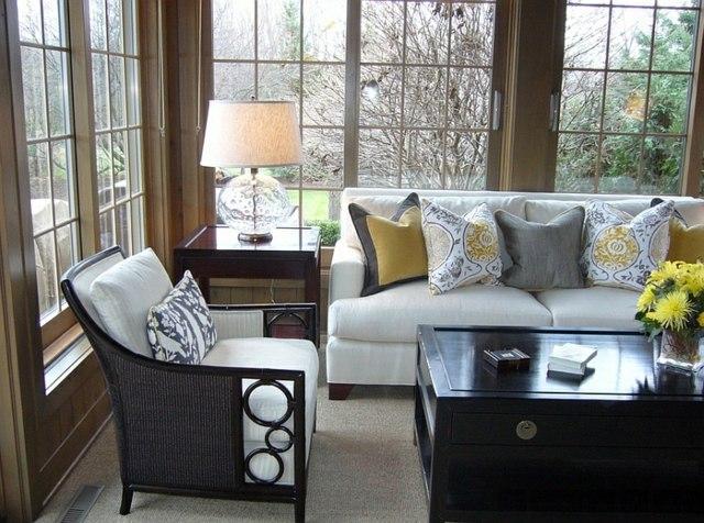 sejour veranda vitrage canape fauteuil coussin