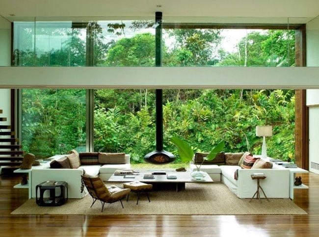 salle-séjour-couleurs-fraîches-plante-verte-mobilier-blanc-coussins-tons-naturels idées salle de séjour