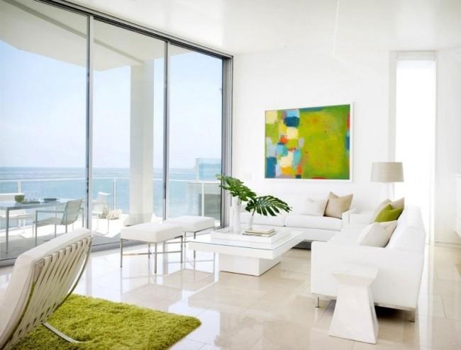 salle-séjour-couleurs-fraîches-tapis-coussins-blanc-vert-tableau-vert-clair idées salle de séjour