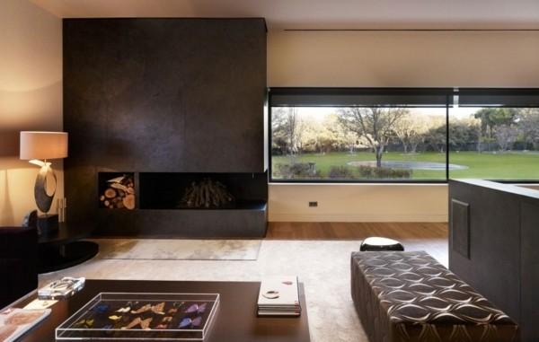 beau salon contemporain avec cheminée et petis bois