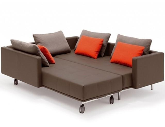canapé-lit-salon-confort-complet-idée-originale-coussins-oranges