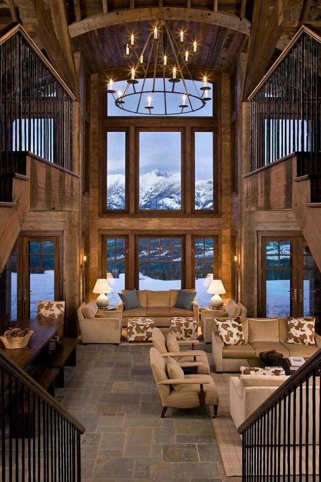 déco-salon-rustique-chalet-montagne-lustre-fer-canapé-fauteuils-beige-clair-coussins-décoratifs déco salon rustique