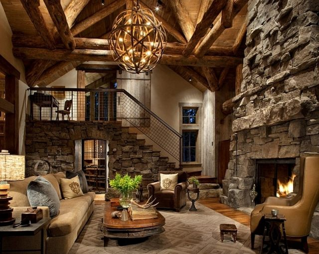 déco-salon-rustique-cheminée-pierre-table-bois-basse-fauteuil-cuir-marron-clair déco salon rustique