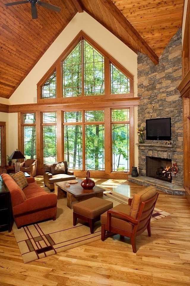 déco-salon-rustique-fauteuils-bois-tapissés-plafond-bois-parquet déco salon rustique