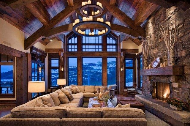 déco-salon-rustique-lustre-fer-forgé-bougies-cheminée-manteau-bois-canapé-angle-grand déco salon rustique