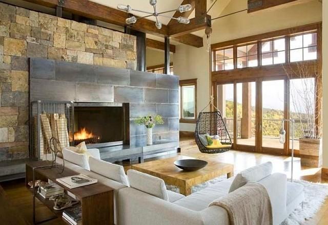 déco-salon-rustique-murs-pierre-canapé-angle-blanc-table-bois-basse déco salon rustique