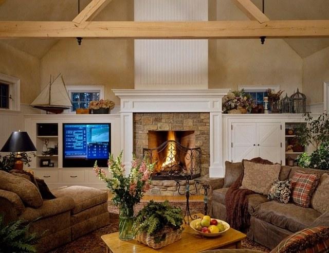 déco-salon-rustique-poutres-bois-canapé-cuir-marron-cheminée-pierre déco salon rustique