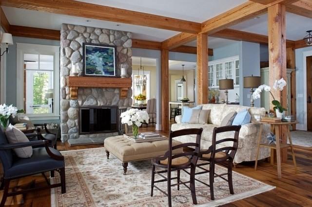 déco-salon-rustique-poutres-bois-cheminée-pierre-manteau-bois-mobilier-élégant déco salon rustique