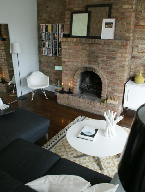 meubles noir sol bois vue cheminee