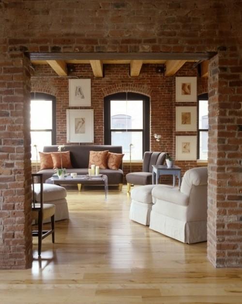 vue salon sol bois murs briques