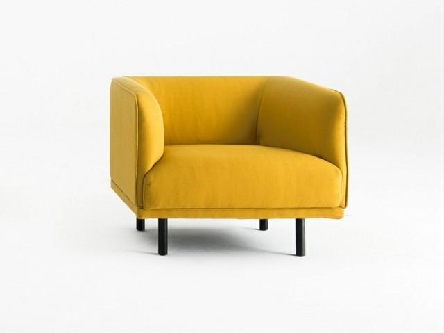 Petit fauteuil jaune par Grado Design Furnitures minimaliste pieds courts