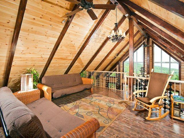 séjour rustique canapé tapis de sol chaise en bois design lampe suspendue