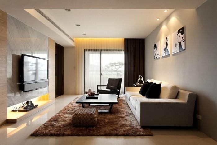salon aménagement idée tapis de sol marron tableau déco mural canapé fauteuil