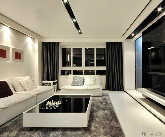 salon intérieur canapé blanc coussins table de salon noire et blanche design