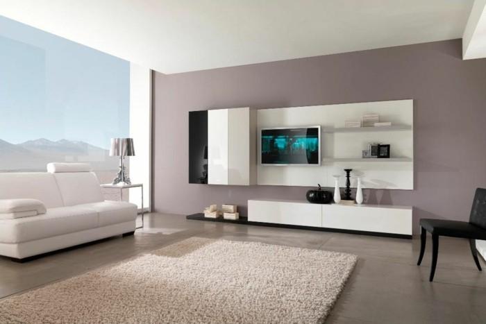intérieur salon canapé cuir blanc tapis de sol beige rose doux télé rangements