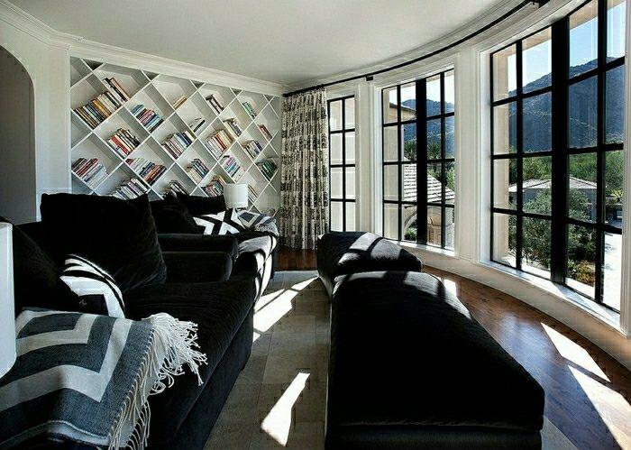 salon bibliothèque originale rangements livre moderne canapé noir