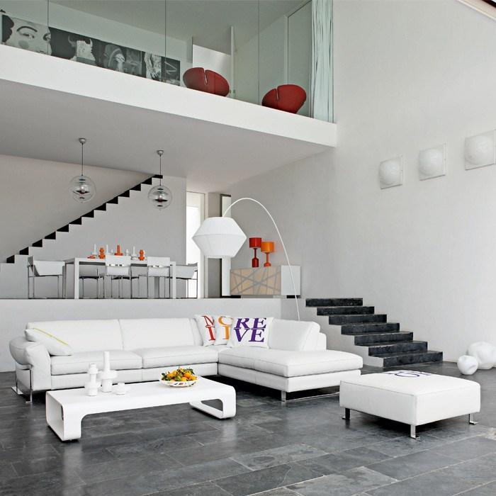aménagement séjour idée canapé d'angle cuir blanc lampe blanche pouf blanc