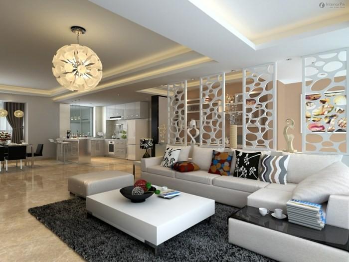 salon aménagement idée lampe suspendue table basse blanche canapé d'angle en cuir coussins aux motifs