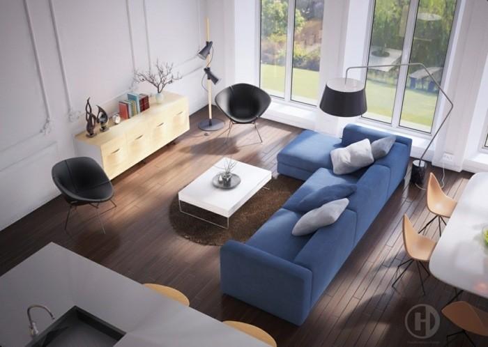 intérieur salon moderne canapé bleu parquet table basse chaises design