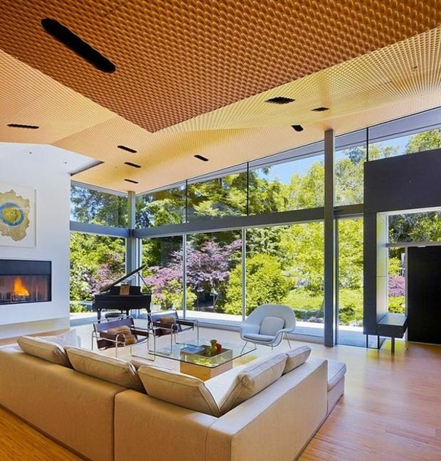vaste salon contemporain baies vitrées donnent jardin