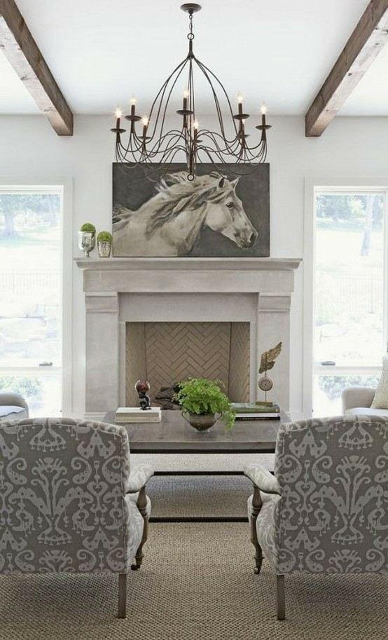 salon design en style rustique moderne cheminée tableau déco lampe suspendue fauteuil gris table de salon basse