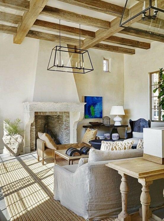 aménagement salon moderne lampe suspendue design canapé gris tapis beige table en bois