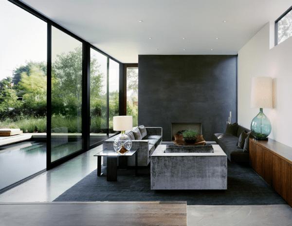 aménagement espace séjour canapé lampe déco tapis de sol noir piscine