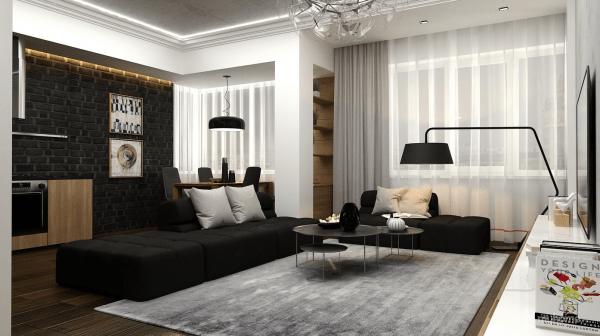 aménagement séjour canapé noir coussins gris lampe design tapis de sol