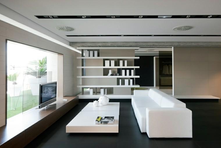 aménagement salon carrelage gris foncé canapé blanc table basse étagères