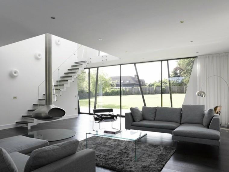 aménagement salon canapé gris moderne tapis de sol table basse en verre
