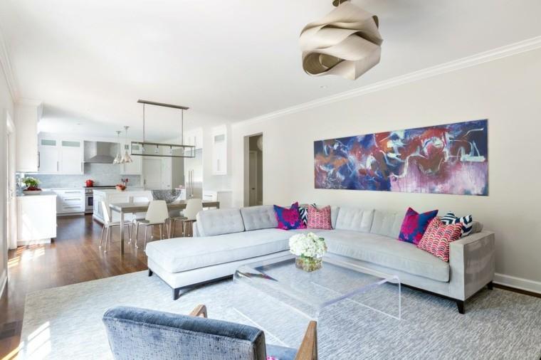 décorer salon moderne canapé d'angle gris coussins motifs fauteuil table en verre design