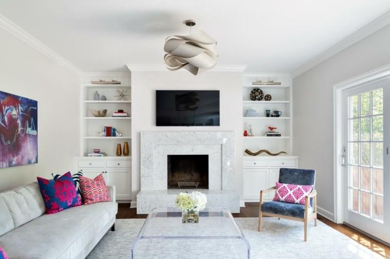 salon moderne gris luminaire design tableau mur coussins motifs table basse en verre tapis de sol gris clair design