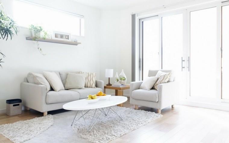 déco salon blanc tapis de sol fleurs coussin canapé table basse design fauteuil