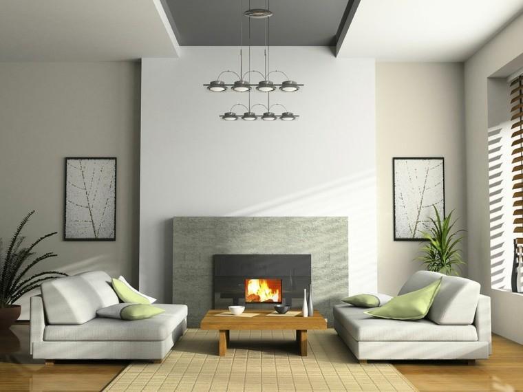 déco salon blanc fauteuil blanc coussin cadre plante cheminée tapis de sol beige