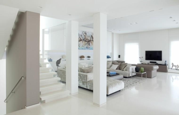 salon déco mur tableau idée canapé gris design fauteuil télé meuble tv