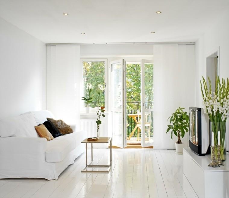 intérieur salon moderne canapé blanc coussin table basse déco plante idée parquet bois blanc