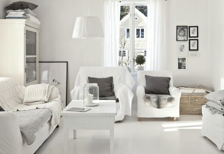 déco salon fauteuil blanc table blanche design luminaire suspension cadre photo