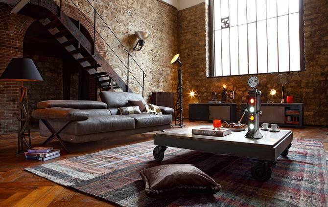 mur brun brique et le tapis gris