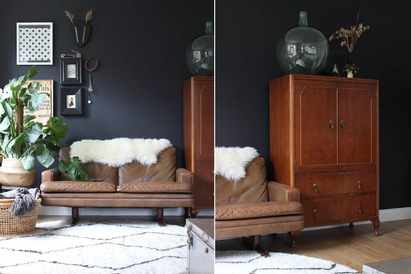 Des meubles en cuir dans une pièce noire
