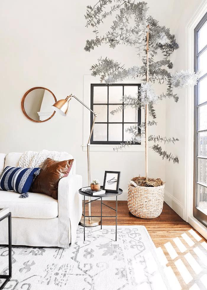 Idées de décoration murale pour le salon afin que vous puissiez enfin remplir cet espace vide